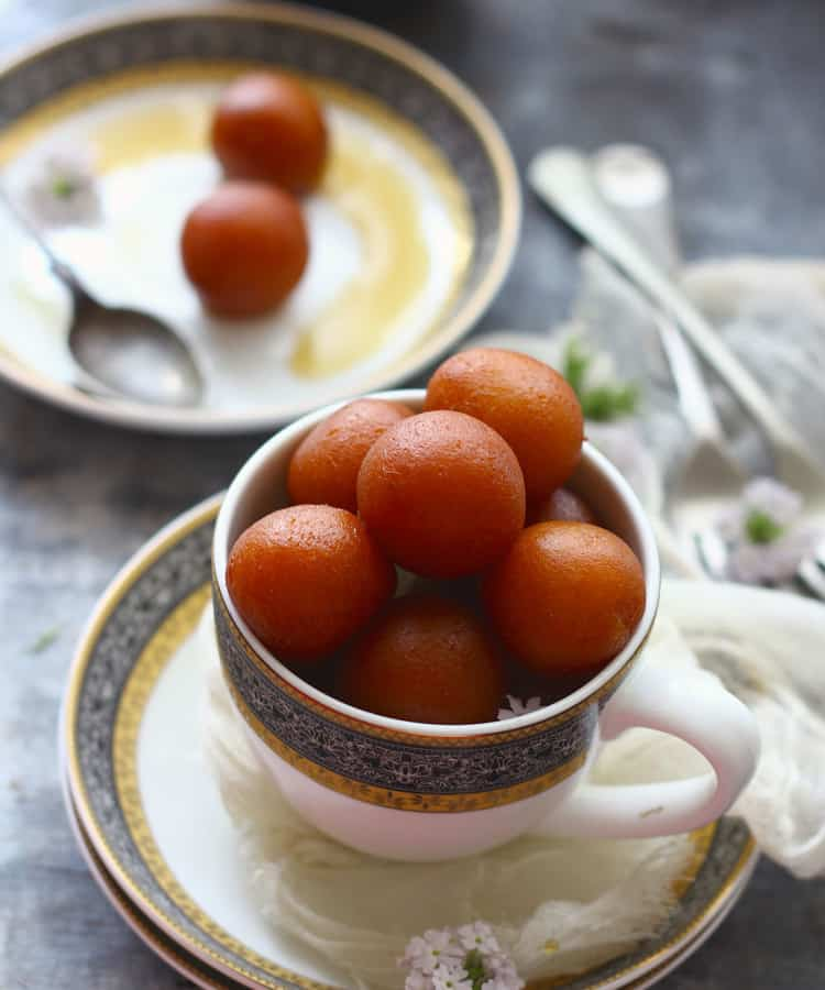 Paneer Gulab Jamun are deep fried cottage cheese dumplings soaked in sugar syrup.