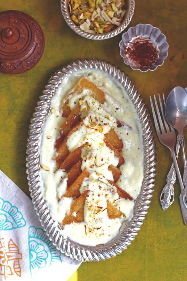 Baked Shahi Tukra Recipe is a bit low on calorie version of this popular Mughlai dessert. Find how to make Baked Shahi Tukra in few simple steps