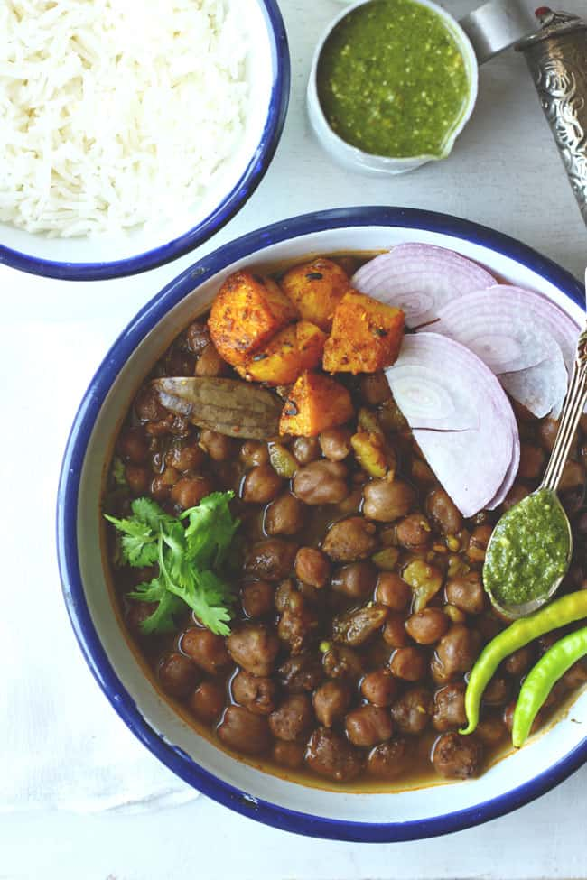 Punjabi Chana Masala is a popular curry popular across India often served with deep-fried bhatura. Find Chana Masala recipe