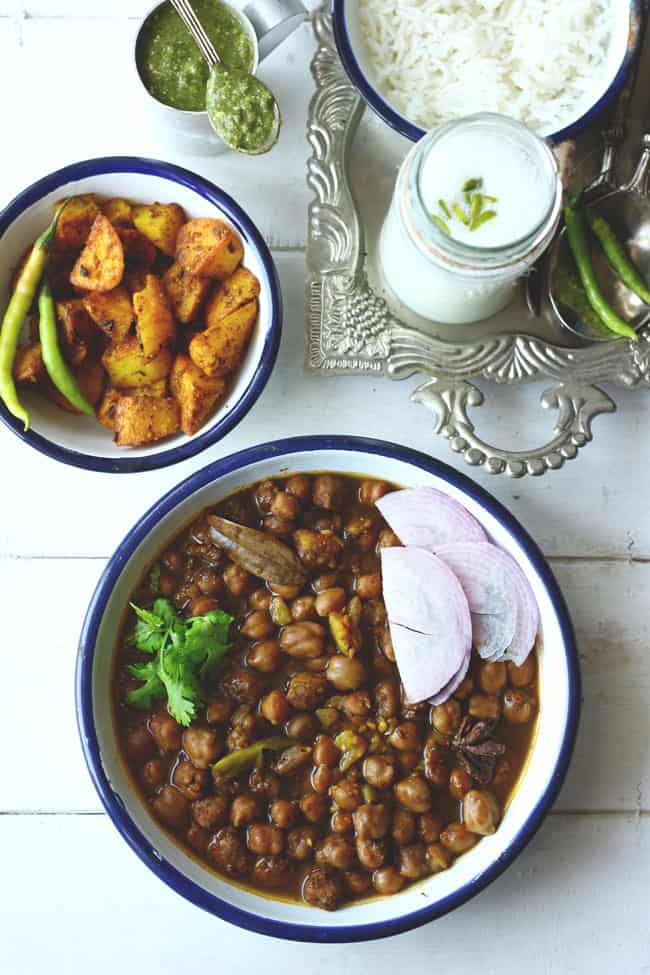 Punjabi Chana Masala is a popular curry popular across India often served with deep-fried bhatura. Find Chana Masala recipe