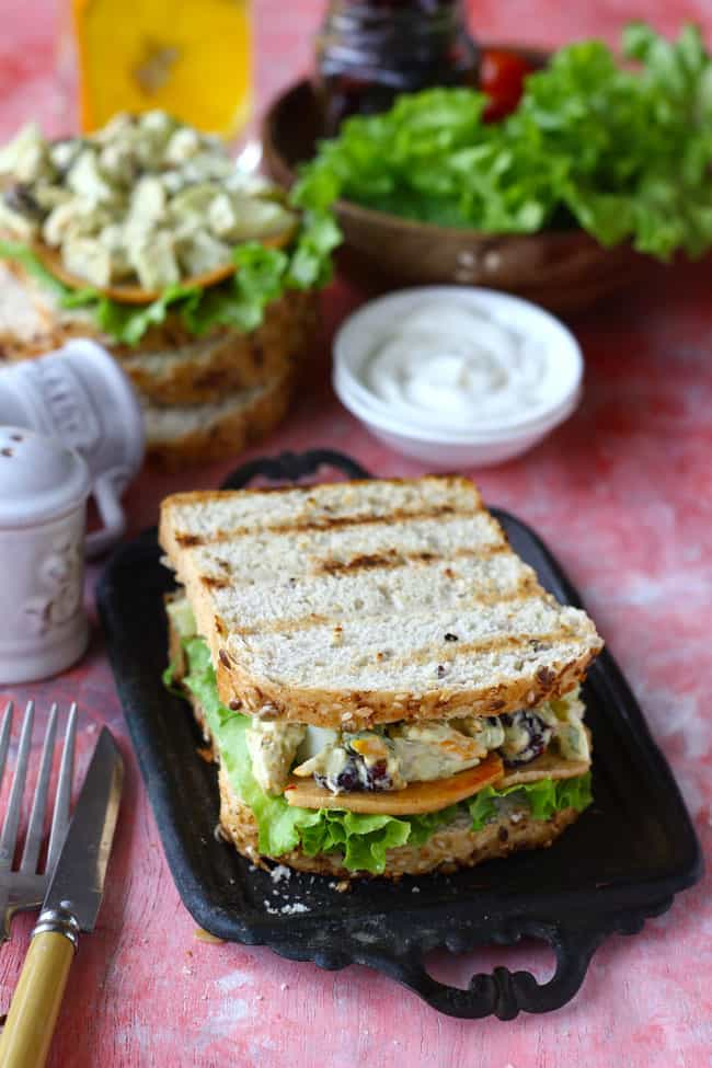Club Sandwich is one of the best ways to have a protein loaded breakfast. Find how to make delicious club sandwich with the leftovers.