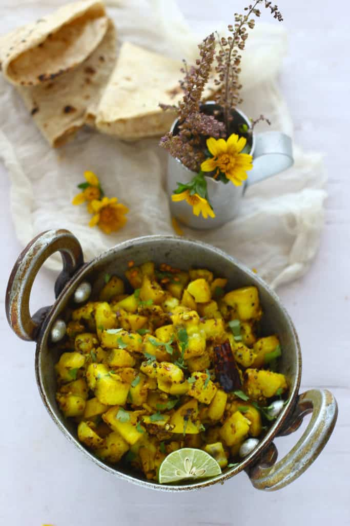Kachhe Kele Ki Sabzi is a no onion - garlic recipe prepared using raw bananas. An excellent gluten free dish.