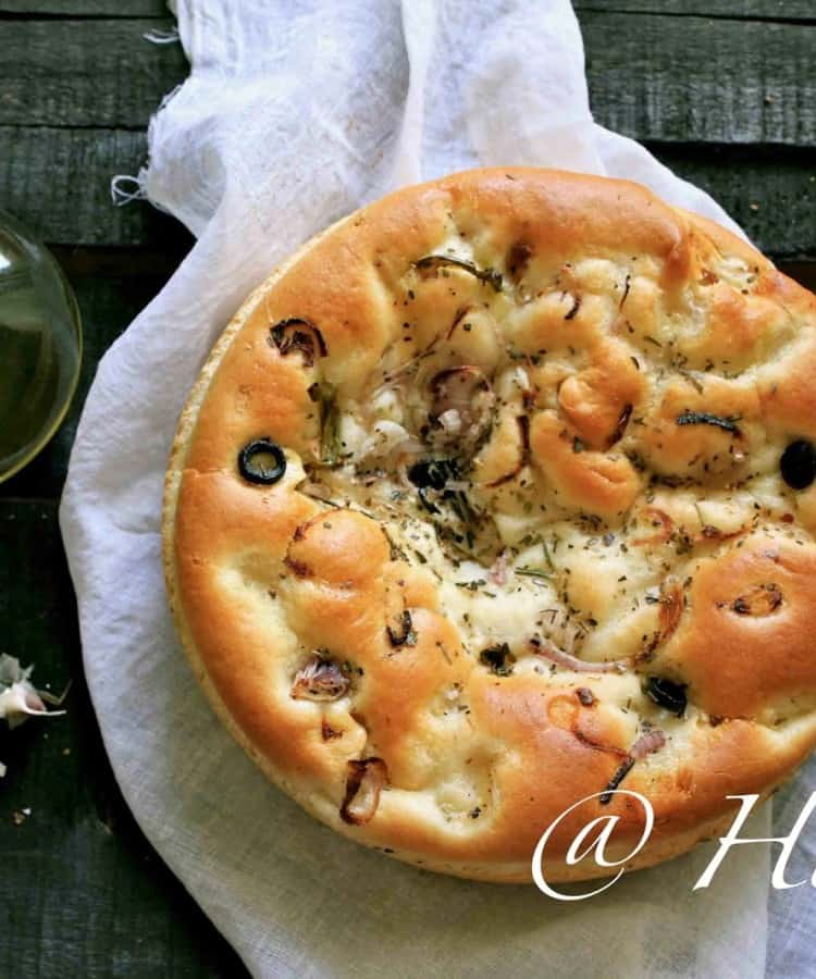 Roasted Onion, Garlic, and Rosemary Focaccia is one of the best bread recipes that happened in my kitchen. Find how to make focaccia in few simple steps