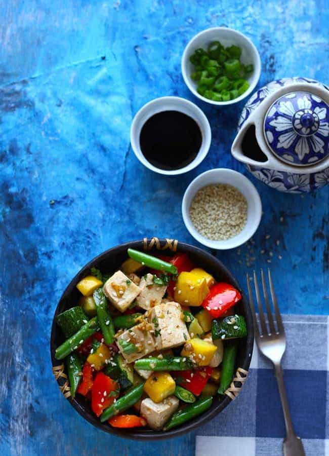Tofu and Vegetable Stir Fry is packed with the health and goodness of colorful, seasonal vegetables – broccoli, beans, bell pepper, and squashes.