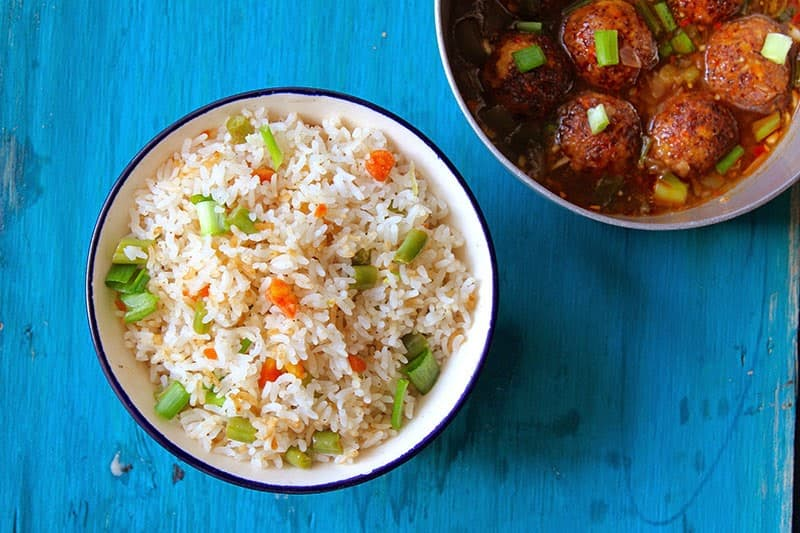 Vegetable Manchurian with Fried Rice is one congenial Indo-Chinese comfort food when I say Indo-Chinese. Find recipe of vegetable manchurian