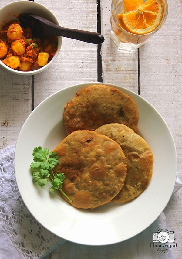 Matar Ki Kachori, the puffed fried Indian bread, the pastry on the outside is firm and crisp while the filling inside is bursting with vibrant flavors.