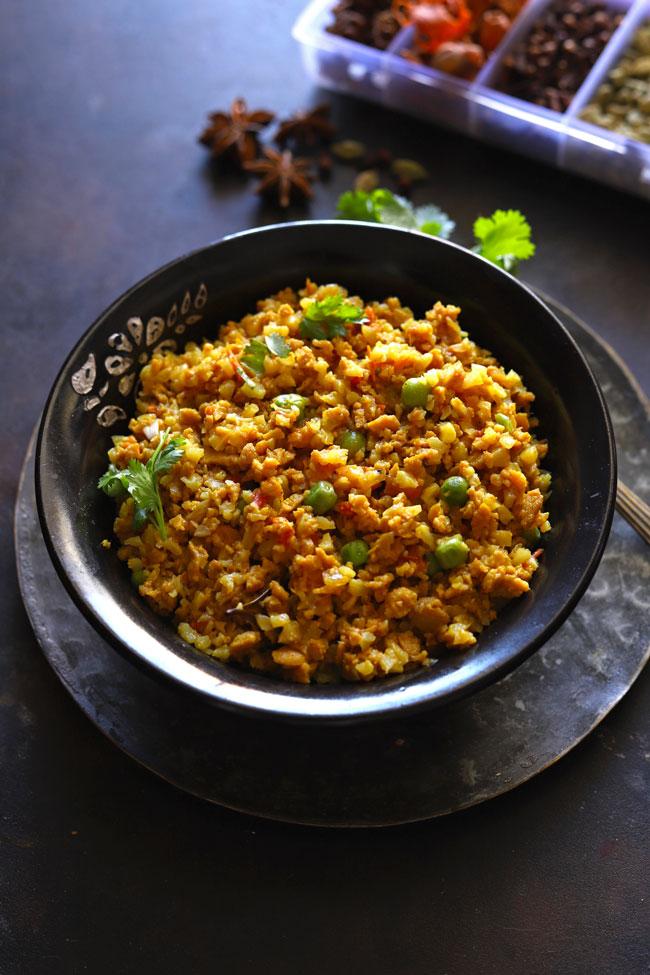 Side shot of vegetarian keema in a black serving bowl.