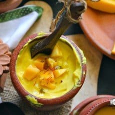 Mango Shrikhand is an Indian sweet treat made with fresh mango pulp, thick yogurt, flavored with aromatics like saffron, cardamom, and pistachio.