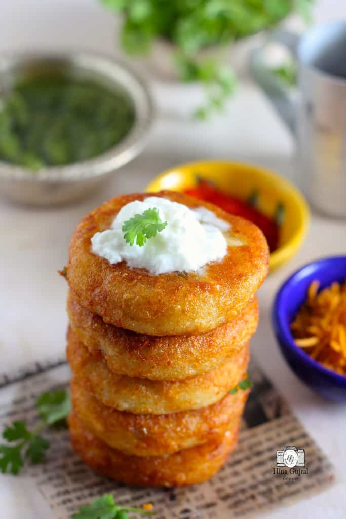 Aloo Tikki Chaat is a delicious Indian street food of crisp potato patties loaded with curd, chutney, and spices.