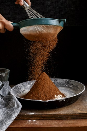 Sifting Cocoa Powder, Ready for Baking