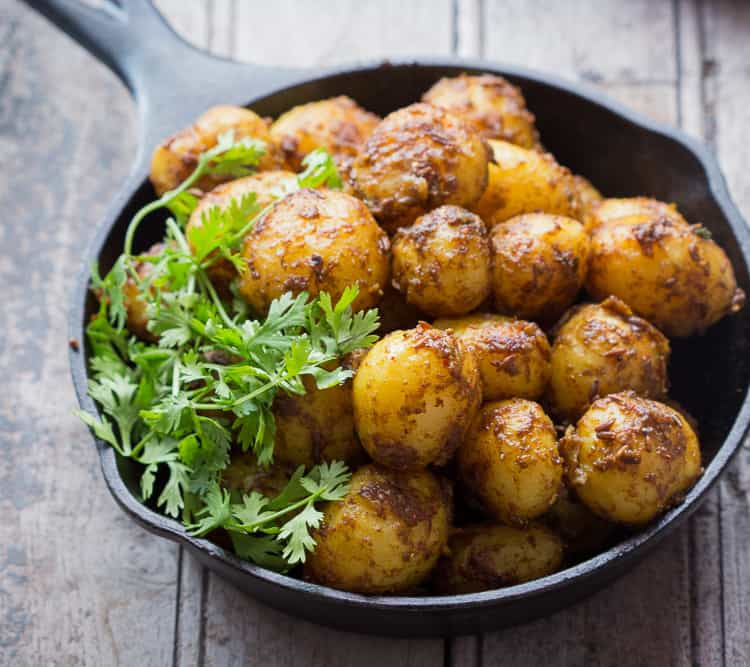 Bombay Potatoes Recipe (Masala Aloo) is the best ever Indian-style roasted potato recipe. Learn how to make Bombay Potatoes in few simple steps