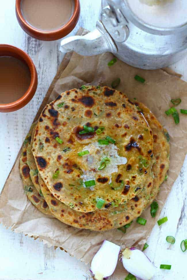 Spring Onion and Paneer Paratha is a wholesome, delicious and super-easy breakfast recipe. Learn how to make Spring Onion and Paneer Paratha in few simple steps