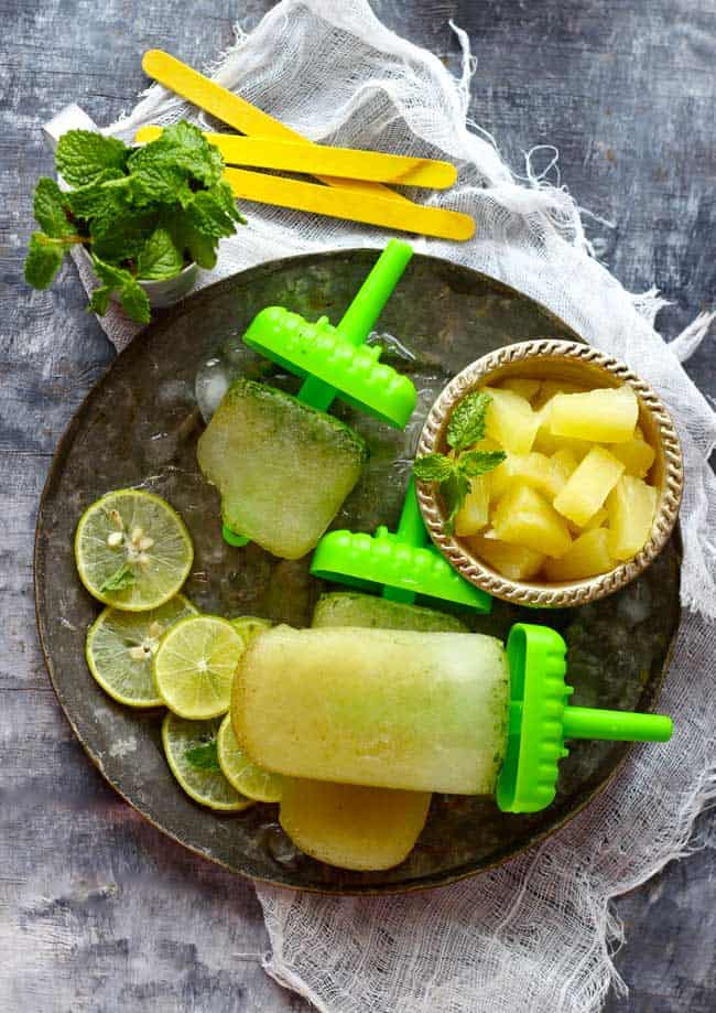 You need 5 ingredients - pineapple, mint, juice, sugar and chaat masala, to make these delicious mint and pineapple popsicles.