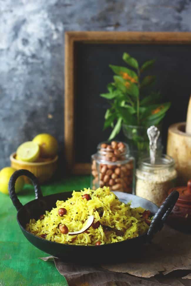 side shot of lemon rice in a cast iron kadhai