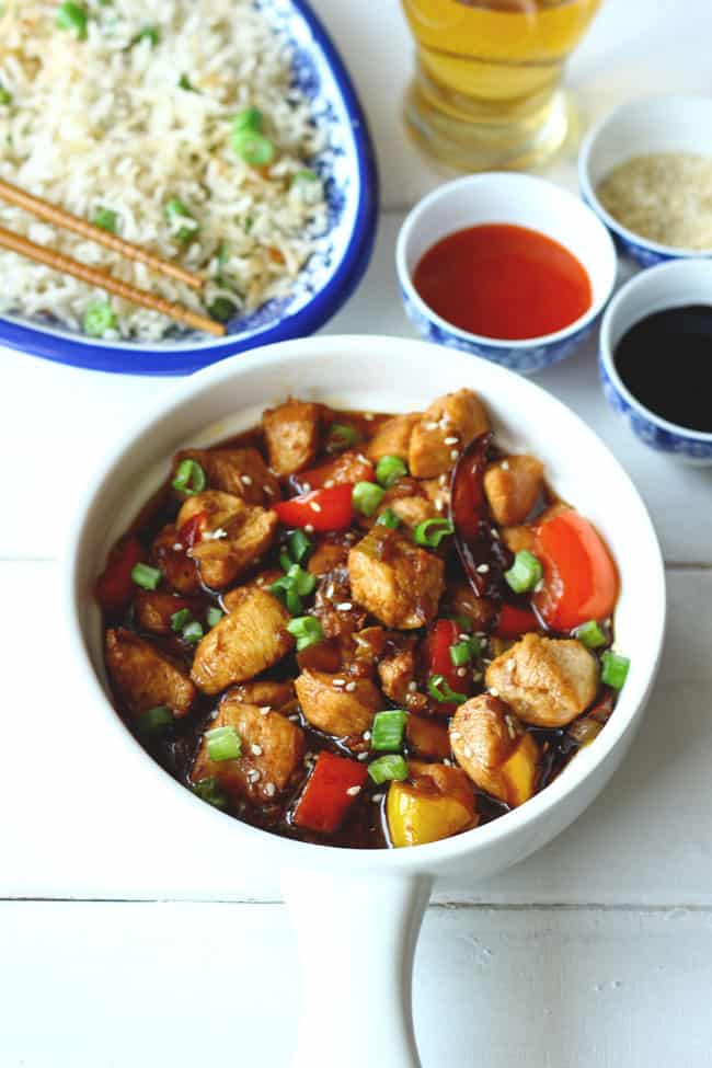 side shot of chicken kung pao served on a ceramic white platter