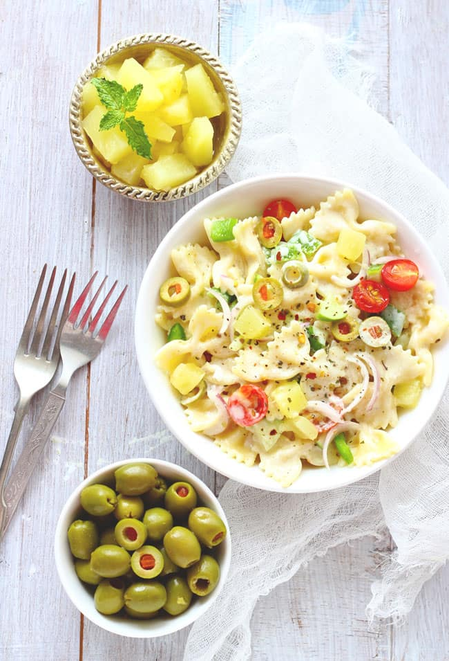 This Summer Pasta Salad is loaded with pineapple, cucumber, olives and a light creamy dressing.
