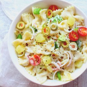 This Summer Pasta Salad is loaded with pineapple, cucumber, olives and a light creamy dressing. Find how to make creamy summer pasta salad.