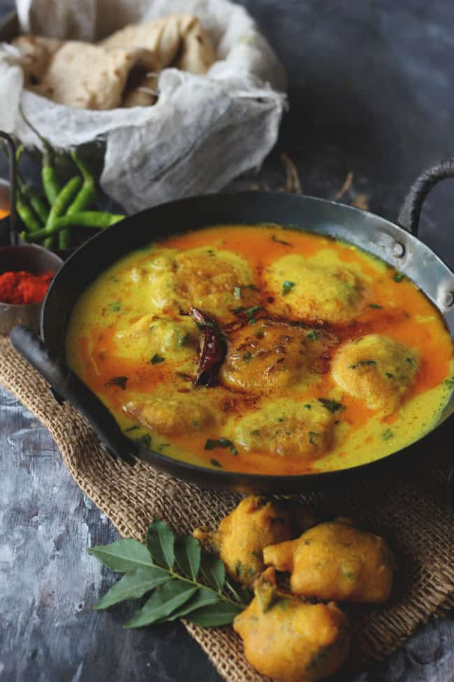 Kadhi Pakora is a gluten-free Indian curry prepared with gram flour and yogurt (curd).