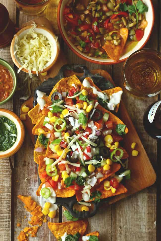 aerial shot of loaded veggies nachos on a platter