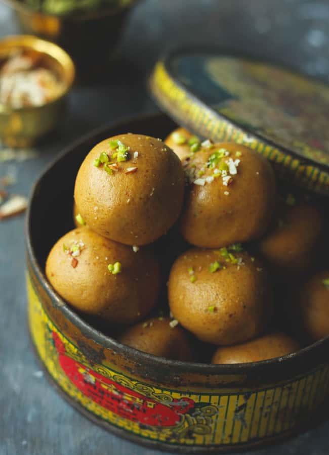 close up shot of besan ke ladoo in a vintage container