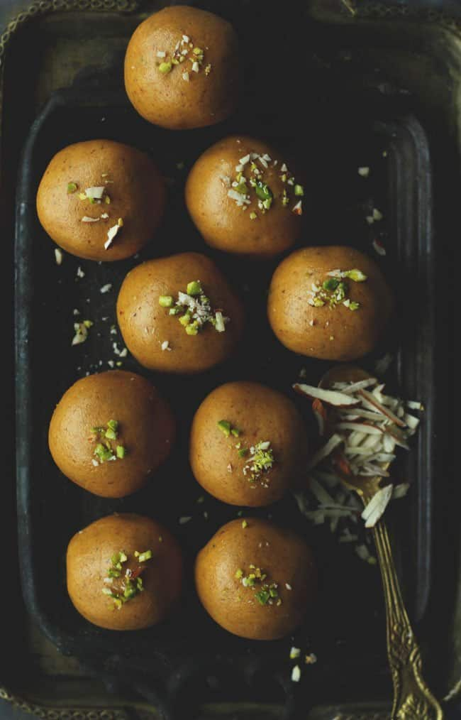 aerial shot of besan ladoo arranged on a black platter