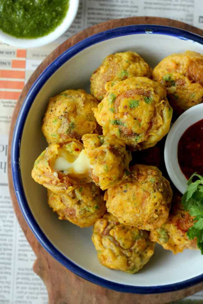 The cheese golgappa pakora is the masala potato stuffed Indian style fritters loaded with cheese.
