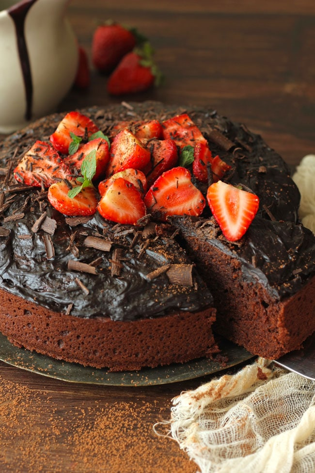 Eggless Chocolate Cake Decorated With Chocolate Frosting And Strawberries