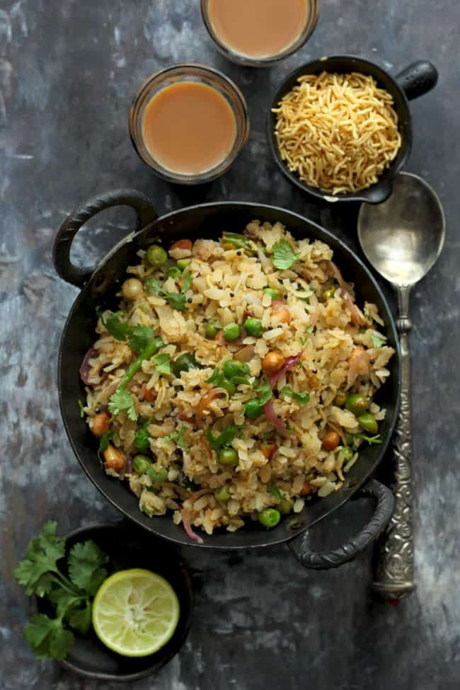 aerial shot of matar poha in a black kadhai