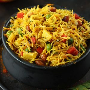 side close up shot of semiya upma in a black serving bowl