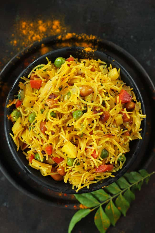 aerial shot of vermicelli upma in a black serving bowl