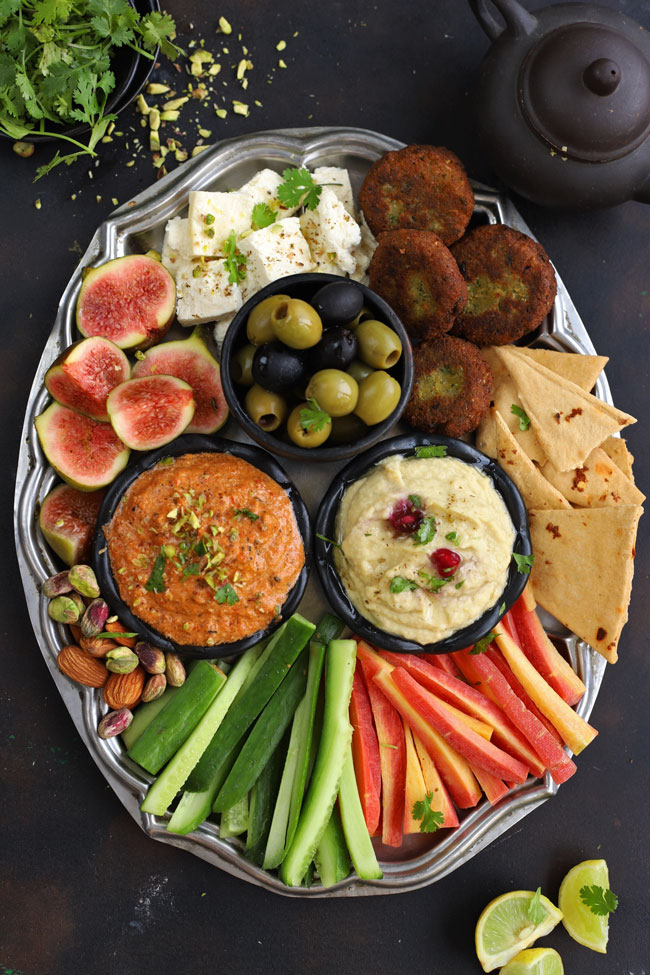 aerial shot of mezze platter on a black surface