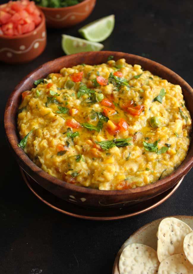 Oats Khichdi In a Brown Bowl