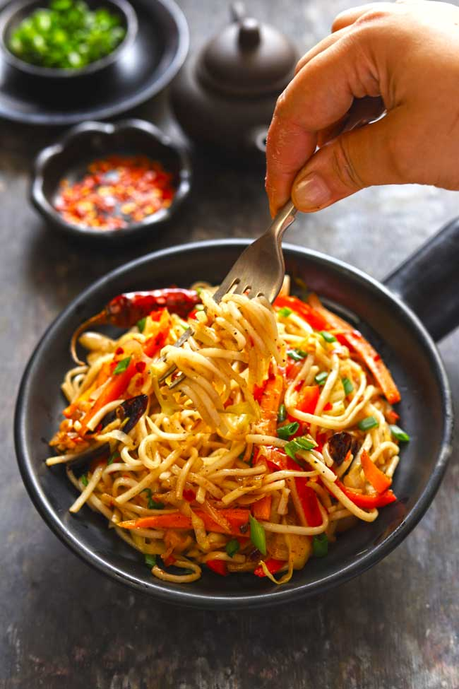 Chilli Garlic Noodles is a spicy, Indian Chinese style noodles stir-fry with loads of vegetables.