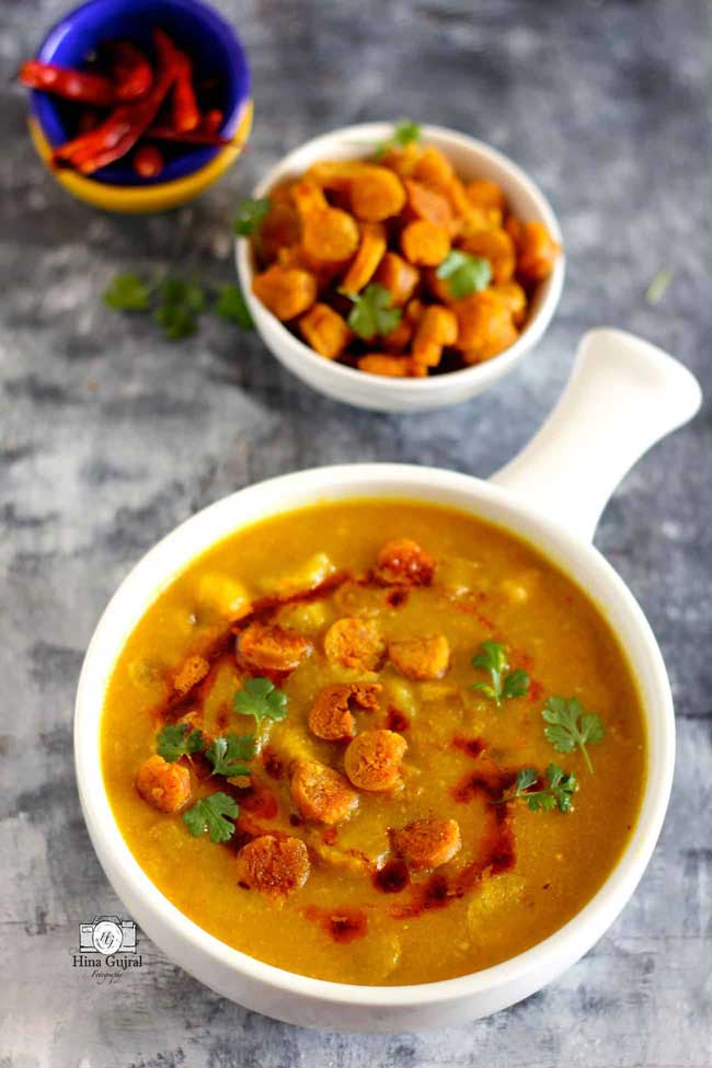 Gatte Ki Sabzi is a popular gluten-free Indian curry prepared with gram flour (besan) and curd.