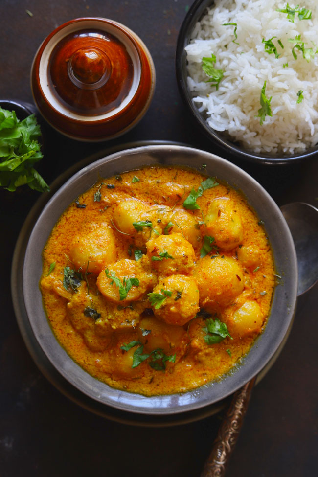 Dum Aloo is a curried baby potato in a vegetarian and gluten-free Mughlai style gravy.