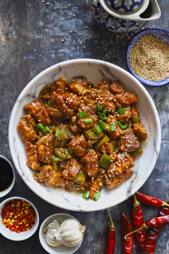 Chilli Chicken is a spice-rich, Indian Chinese style stir-fry chicken.