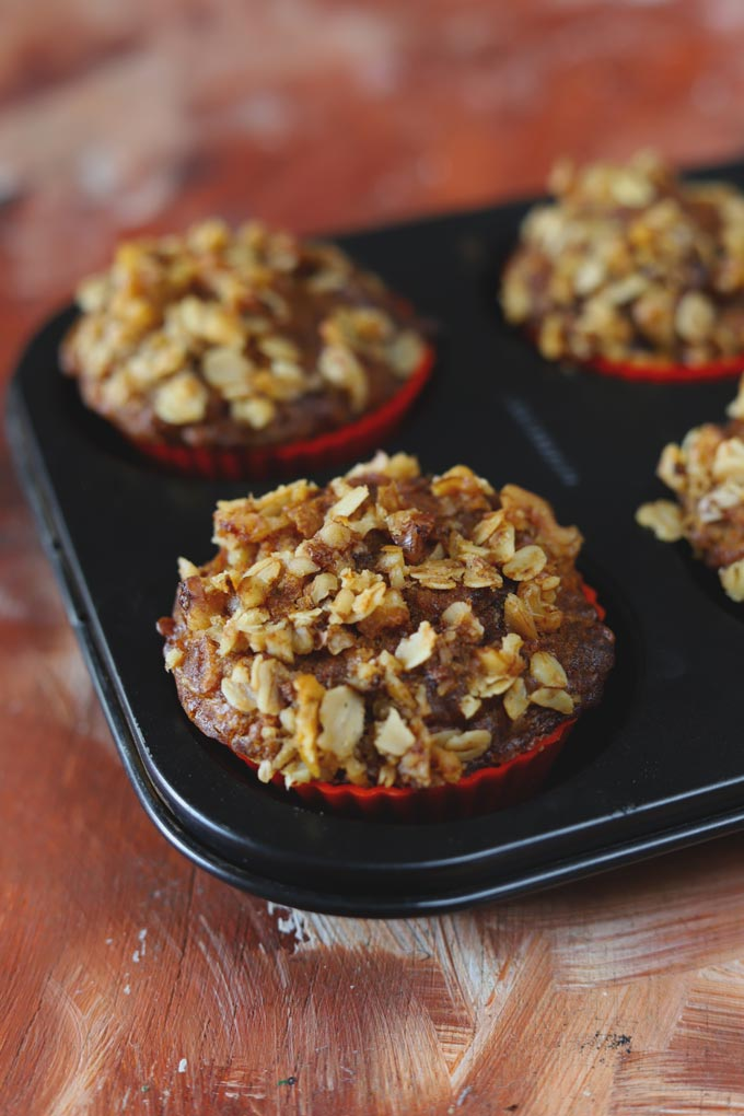 Apple Muffins With Crumbly Oats Streusel Topping in a Black Muffin Tray