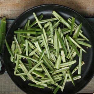 Thinly Sliced Okra In A Black Bowl