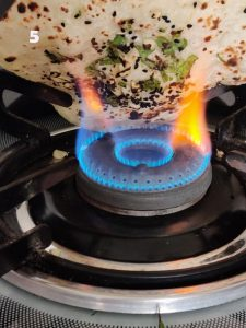 Naan Bread Cooking On a Gas Stove Flame