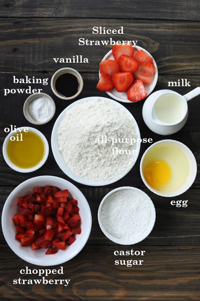 Strawberry Cake Ingredients - Flour, White Sugar, Baking Powder, Strawberry Chopped & Sliced, Egg, Milk, Vanilla, Olive Oil