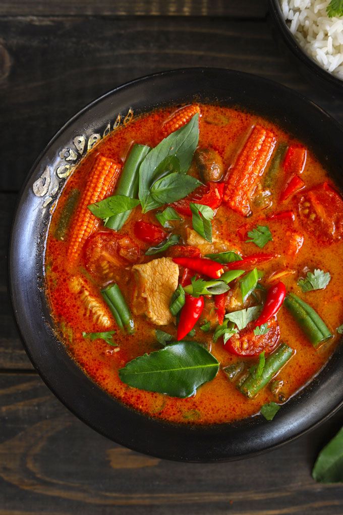 Thai Red Chicken Curry In A Black Bowl
