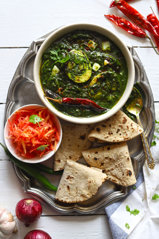 Spinach Egg Curry, Grated Carrot, Chapati In A Plate
