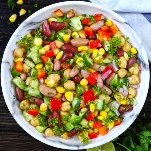 Aerial shot of Mexican style mixed beans salad in a white bowl