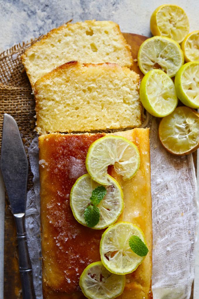 Aerial shot of sliced pound cake loaf garnished with lemon.