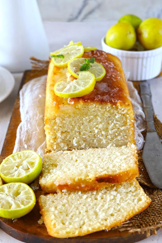 Side shot of sliced lemon pound cake loaf
