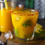 side shot of virgin mango mojito in a glass