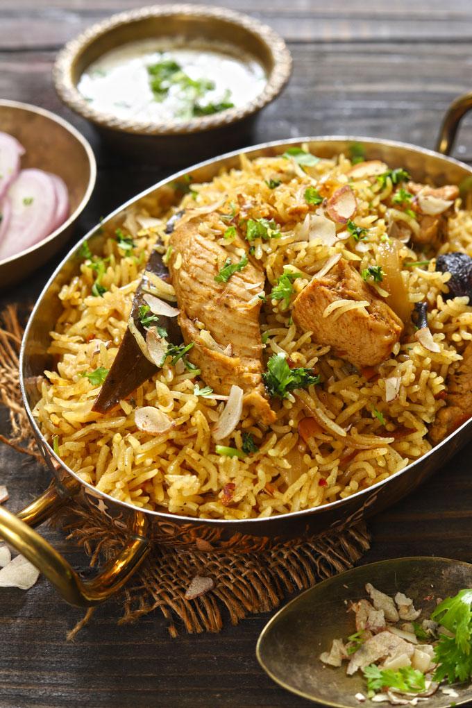 side shot of chicken pulao in an oval serveware