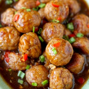 close up shot of Asian chicken meatballs in a serving bowl