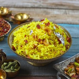 side close up shot of zarda pulao in a silver serving bowl