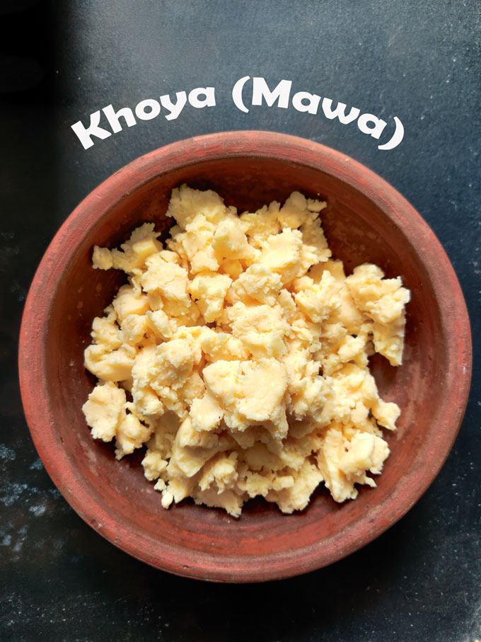 aerial shot of crumbled khoya (mawa) in a earthen bowl